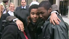 Akiel Eubank (centre) and Gregory Sappleton embrace with Sappleton's mother after being acquitted on Monday, Dec. 13, 2010 in the 2007 shooting death of 11-year-old Ephraim Brown.