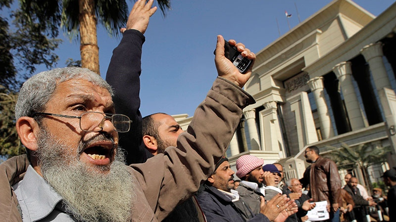 Islamists chant slogans supporting President Mohammed Morsi in front of the Supreme Constitutional Court in Cairo, Egypt, Thursday, Dec. 20, 2012. (AP / Amr Nabil)
