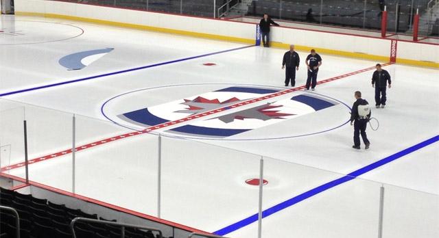 Technicians work on the ice at the MTS Centre in Winnipeg on Jan. 8, 2013.