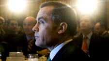 Bank of Canada Governor Mark Carney listens as he's introduced before speaking at the Economic Club of Canada lunch in Toronto on Monday, December 13, 2010. (Nathan Denette / THE CANADIAN PRESS)