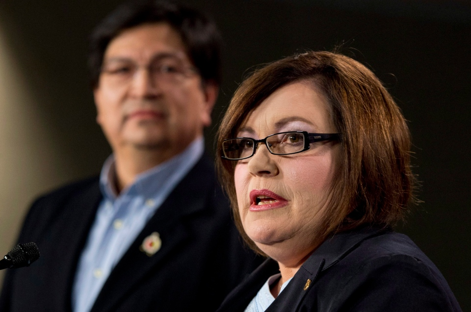 National Vice-Chief Ron Swain looks on as Congress of Aboriginal Peoples National Chief Betty Ann Lavallée responds to a question during a news conference about the impact of a federal court decision on Métis and Non-Status Indians, in Ottawa, Tuesday, Jan. 8, 2013. (Adrian Wyld / THE CANADIAN PRESS)