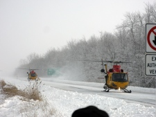 Two Canadian Forces CH-146 Griffon helicopters land to help stranded drivers on Highway 402 in Wyoming, Ont. Tuesday, Dec. 14, 2010. (Beth Campbell / MyNews.CTV.ca)