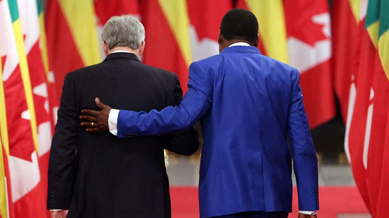 Prime Minister Stephen Harper and Thomas Boni Yayi, president of the Republic of Benin, leave a joint news conference on Parliament Hill in Ottawa, Tuesday, Jan. 8, 2013. (Fred Chartrand / THE CANADIAN PRESS)