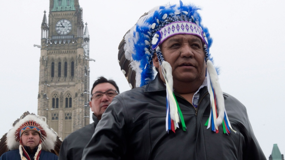 Steve Courtoreille, Chief of the Mikisew Cree First Nation walks off Parliament Hill after speaking about legal action against the federal government in Ottawa, January 8, 2013. (Adrian Wyld / THE CANADIAN PRESS)