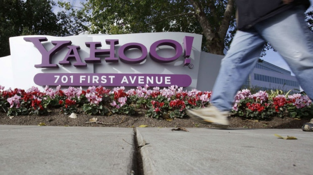 In this photo taken Dec. 1, 2010, a person walks by Yahoo! headquarters in Sunnyvale, Calif. (AP Photo/Paul Sakuma)