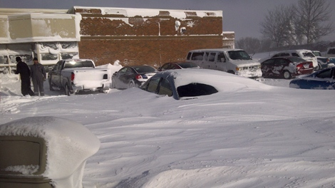 Snow is piled up at the Tim Hortons at Reese Corners, east of Sarnia, Ont., Tuesday, Dec. 14, 2010. (Brandon Junkin for CTV News)