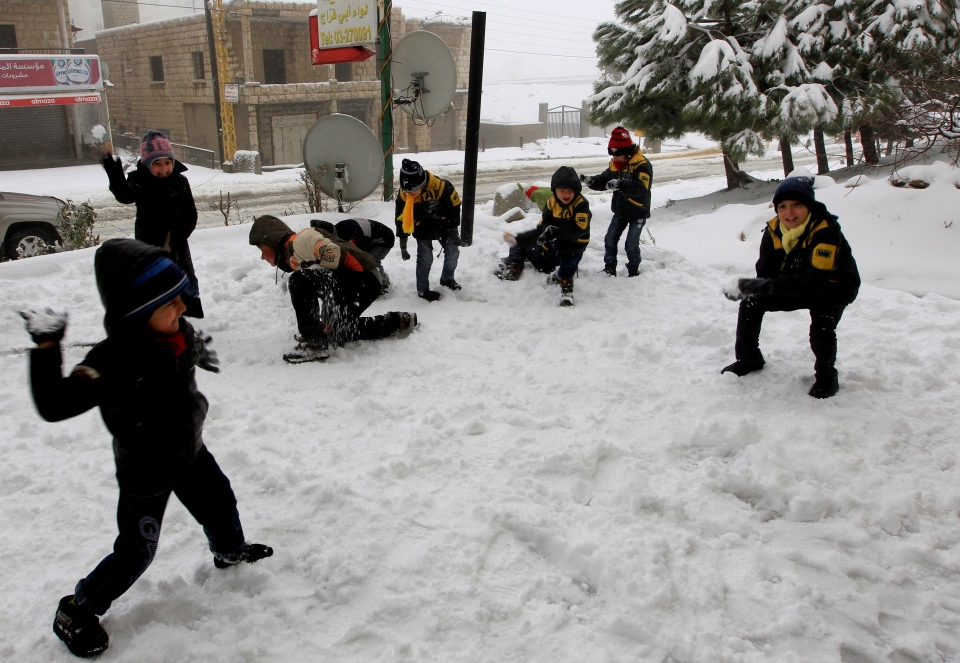 Syrian refugee children have a snowball fight at the mountain town of Bhamdoun, east of Beirut, Lebanon, Wednesday, Jan. 9, 2013. (AP Photo/Bilal Hussein)