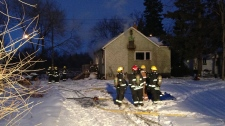 Crews clean up after a fire on Goulet Street.