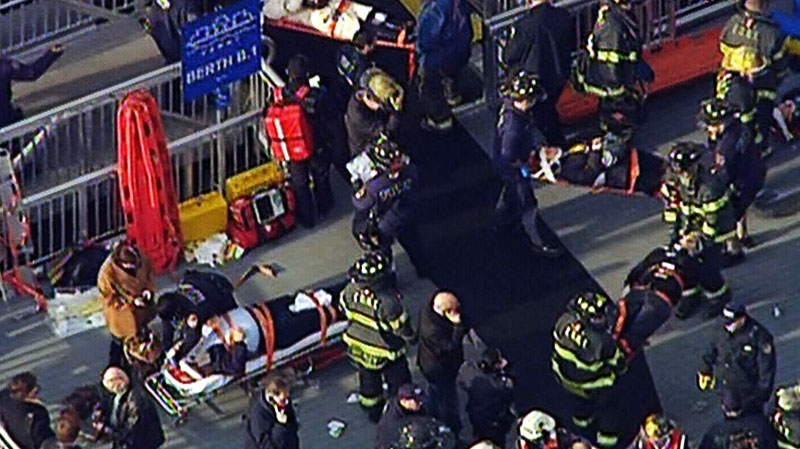 Emergency workers attend injured ferry passengers in New York on Jan. 9, 2013.