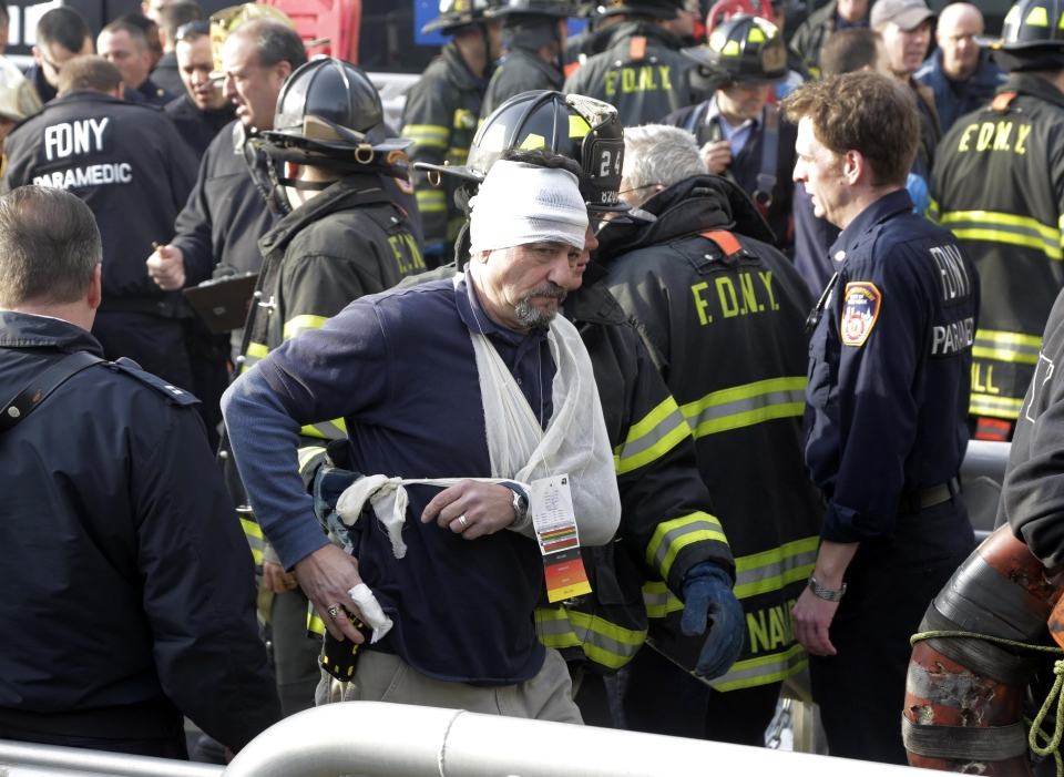 An injured passenger of the Seastreak Wall Street ferry is aided by New York City firefighters, in New York, Wednesday, Jan. 9, 2013. (AP / Richard Drew)