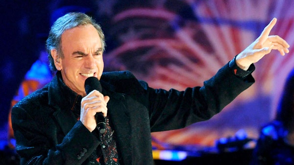In this July 3, 2009 file photo, Neil Diamond performs with the Boston Pops on the Esplanade in Boston. (AP / Lisa Poole, file)