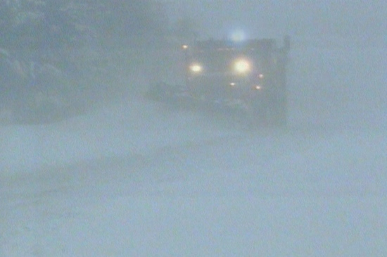A snowplow works to clear roads in the county of Simcoe early Tuesday, Dec. 14, 2010.