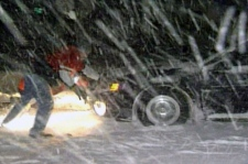 Motorists attempt to free their cars from snow banks on Highway 402, near Sarnia, Ont., early Tuesday, Dec. 14, 2010.