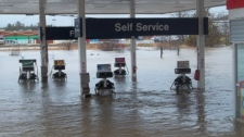 A gas station is flooded in St. Stephen, N.B., Monday, Dec. 13, 2010. (Allecia Fraser / MyNews.CTV.ca)