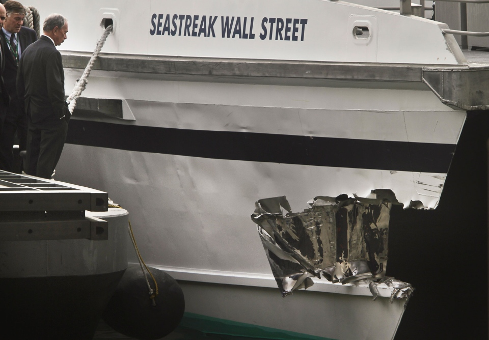 Mayor Michael Bloomberg surveys the damage to a passenger ferry after it crashed in New York on Wednesday, Jan. 9, 2013. (AP / Bebeto Matthews)