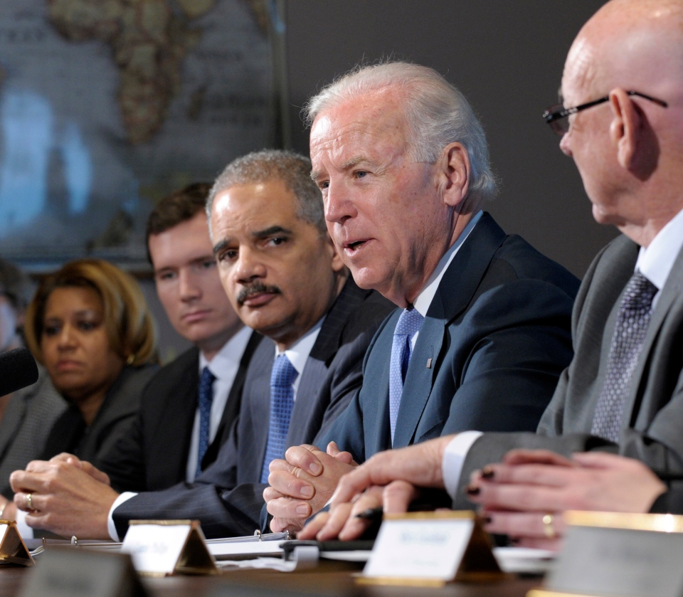 U.S. Vice President Joe Biden, with Attorney General Eric Holder at left, speaks during a meeting with victims' groups and gun safety organizations in the Eisenhower Executive Office Building on the White House complex in Washington, Wednesday, Jan. 9, 2013. (AP / Susan Walsh)
