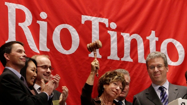 Rio Tinto CEO Tom Albanese, right, watches as his mother, Rosemarie Helm, gavels the market closed after he rang the New York Stock Exchange closing bell, Wednesday, Oct. 6, 2010. (AP Photo/Richard Drew)