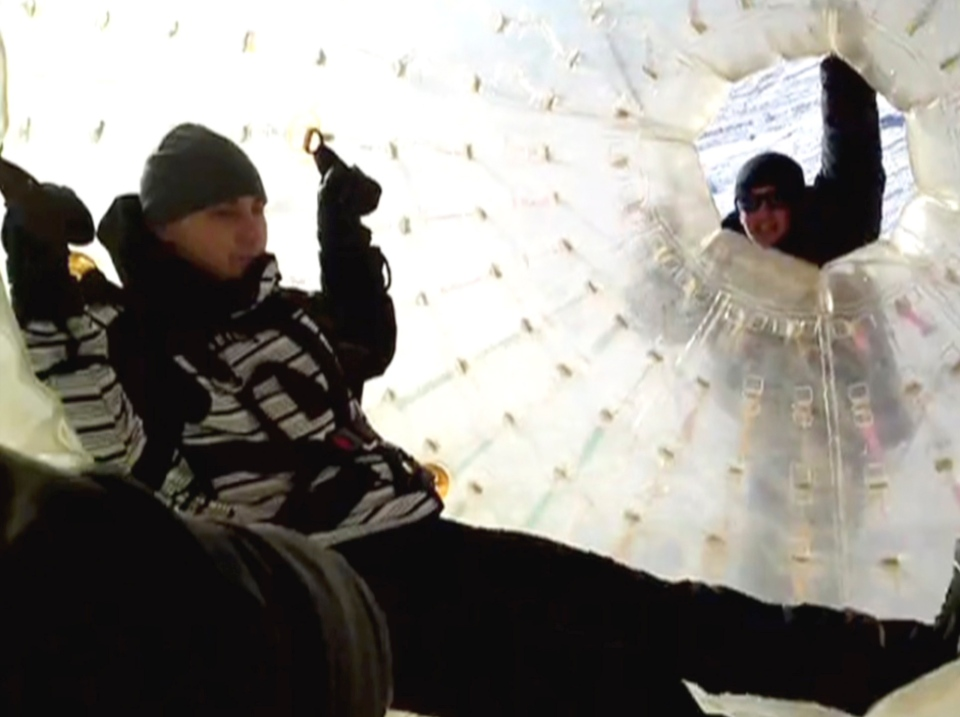 Denis Burakov, left, is seen inside a large plastic ball called a zorb, along with another man, before tragedy struck at a winter sports venue at Dombai in the Caucasus Mountains of southern Russia, on Thursday, Jan. 3, 2013. (AP / Family photo provided by Yekaterina Achkasova, APTN)