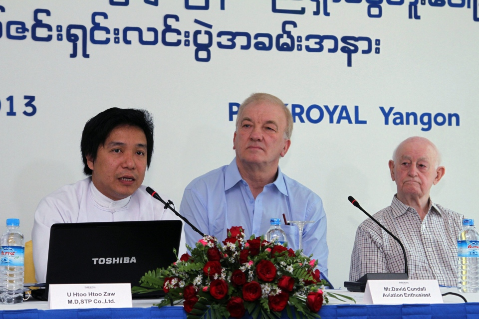 Htoo Htoo Zaw, left, managing director of Shwe Taung Paw Company, talks to journalists during a press conference at Park Royal hotel in Yangon, Myanmar, Wednesday, Jan. 9, 2013. (AP / Khin Maung Win)