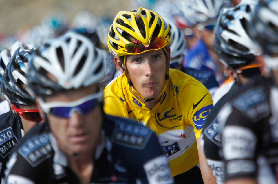 In this July 14, 2010 file photo, Andy Schleck of Luxembourg, wearing the overall leader's yellow jersey, rides in the pack during the 10th stage of the Tour de France cycling race in Gap, France. (AP / Christophe Ena)