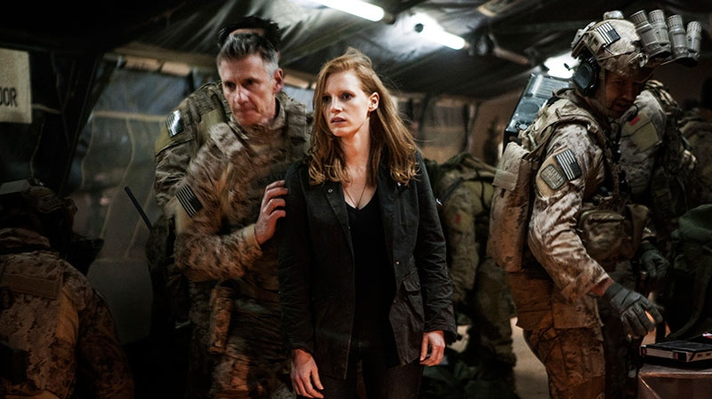 Jessica Chastain, centre, plays a member of the elite team of spies and military operatives stationed in a covert base overseas, with Christopher Stanley, left, and Alex Corbet Burcher, right, who secretly devote themselves to finding Osama Bin Laden in a scene from Alliance Films' 'Zero Dark Thirty.'