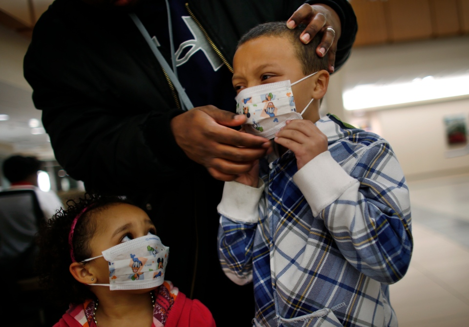 Here Damien Dancy puts masks on his children Damaya, 3, left, and Damien, 7, at Sentara Princess Anne Hospital in Virginia Beach, Va., on Wednesday, Jan. 9, 2013. (The Virginian-Pilot, Stephen M. Katz)