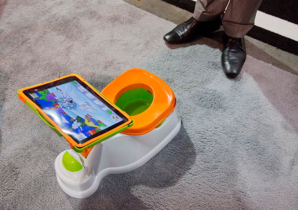 The iPotty for iPad potty training device is see on display at the Consumer Electronics Show, Wednesday, Jan. 9, 2013, in Las Vegas. (AP Photo/Julie Jacobson)