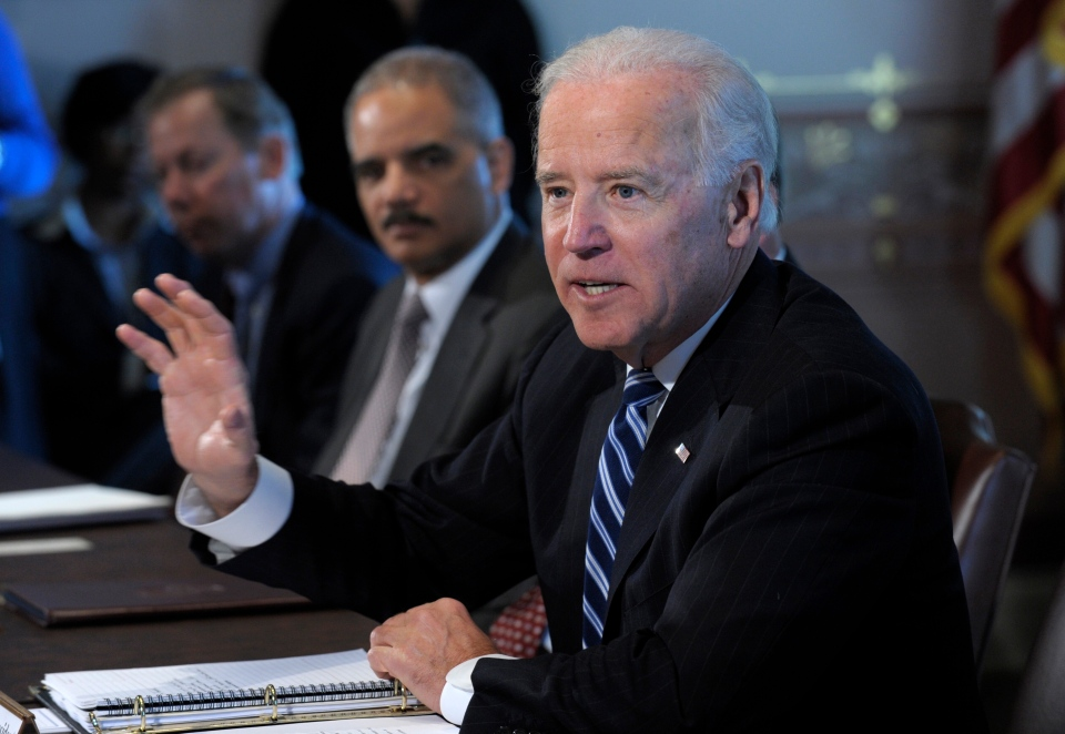 U.S. Vice President Joe Biden, accompanied by Attorney General Eric Holder, gestures as he speaks during a meeting with Sportsmen and Women and Wildlife Interest Groups and member of his cabinet, in the Eisenhower Executive Office Building on the White House complex in Washington, Thursday, Jan. 10, 2013. (AP / Susan Walsh)
