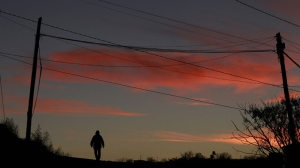 A man walks up a street as the day ends in Ciudad Juarez, Mexico Tuesday, Dec. 14, 2010. (AP / Dario Lopez-Mills)