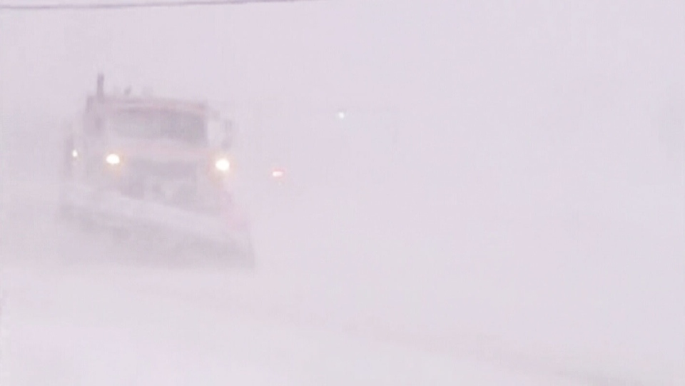 A snowplow is barely visible as a major snowstorm strikes N.L. on Thursday, Jan. 10, 2013.