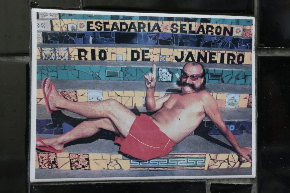 "An undated photo of Chilean artist Jorge Selaron decorates a tile that is part of a wall on a public staircase he decorated and titled the ""Selaron Stairway"" in Rio de Janeiro, Brazil, Thursday, Jan. 10, 2013. (AP Photo)"