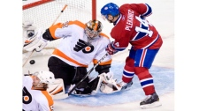 Montreal Canadiens' Tomas Plekanec (14) scores on Philadelphia Flyers goaltender Sergei Bobrovsky during third period NHL hockey action in Montreal on Wednesday, December 15, 2010.THE CANADIAN PRESS/Graham Hughes