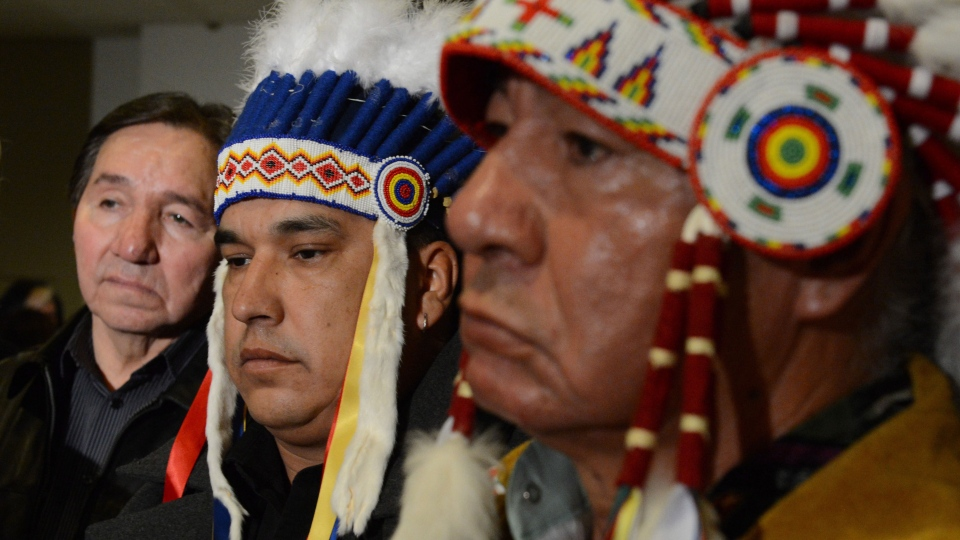 Assembly of First Nations Regional Chief Bill Traverse closes his eyes as he stands with fellow Manitoba Chiefs during a press conference following a meeting with the Assembly of Manitoba Chiefs in Ottawa on Thursday, January 10, 2013. (Sean Kilpatrick / THE CANADIAN PRESS)