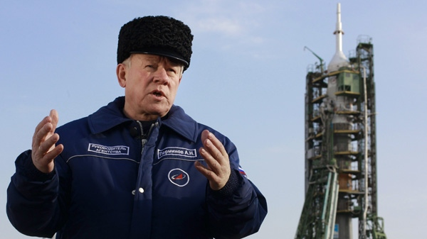 Russia's Federal Space Agency chief Anatoly Perminov speaks to the Media at the launch pad at the Russian leased Baikonur cosmodrome, Kazakhstan, Wednesday, Dec. 15, 2010, with the Russian Soyuz TMA-20 in the background. (AP Photo/Dmitry Lovetsky)