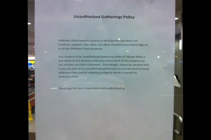A note was posted on the doors of Midtown Plaza Thursday outlining the mall's stance on demonstrations.
