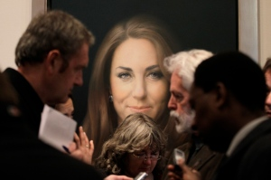 Members of the media talk to artist Paul Emsley, centre right, in front of his newly-commissioned portrait of Kate, Duchess of Cambridge, on display at the National Portrait Gallery in London, Friday, Jan. 11, 2013. (AP / Sang Tan)