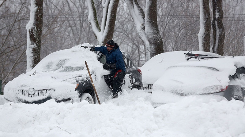 Don Decker starts to work on clearing his car during the first major snowstorm of the season, in St. John's, N.L., on Friday Jan. 11, 2013. (Paul Daly / THE CANADIAN PRESS)