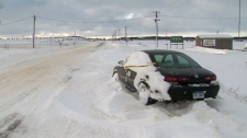 A car sits abandoned on a stretch of Highway 402, Wednesday, Dec, 15, 2010.