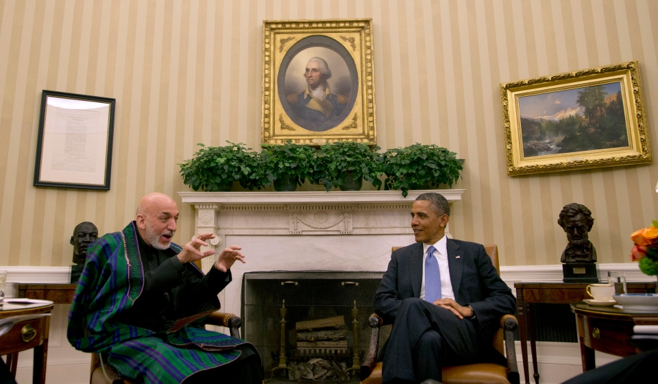Afghan President Hamid Karzai gestures as he speaks with President Barack Obama during their bilateral meeting in the Oval Office of the White in Washington, Friday, Jan. 11, 2013. (AP Photo/Pablo Martinez Monsivais)