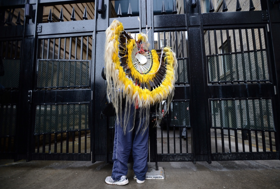 Gordie Odjig of Wikwemikong stands at the west gate to the Langevin Block during the aboriginal meeting in Ottawa on Friday, Jan. 11, 2013. (Sean Kilpatrick / THE CANADIAN PRESS)
