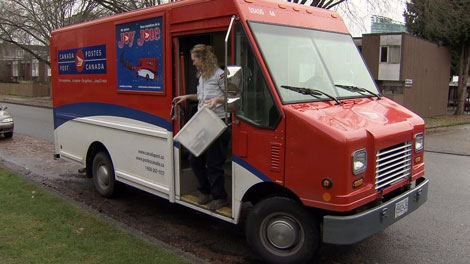 A Canada Post worker leaves a mail truck in Surrey. Dec. 16, 2010. (CTV)