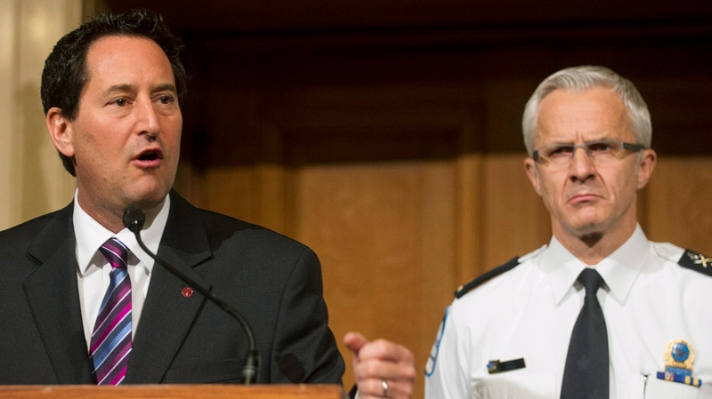 Montreal Mayor Michael Applebaum, left, and Montreal chief of police Marc Parent speak at a news conference at City Hall in Montreal, Friday, January 11, 2013, where they announced the formation of a new anit-corruption unit. THE CANADIAN PRESS/Graham Hughes