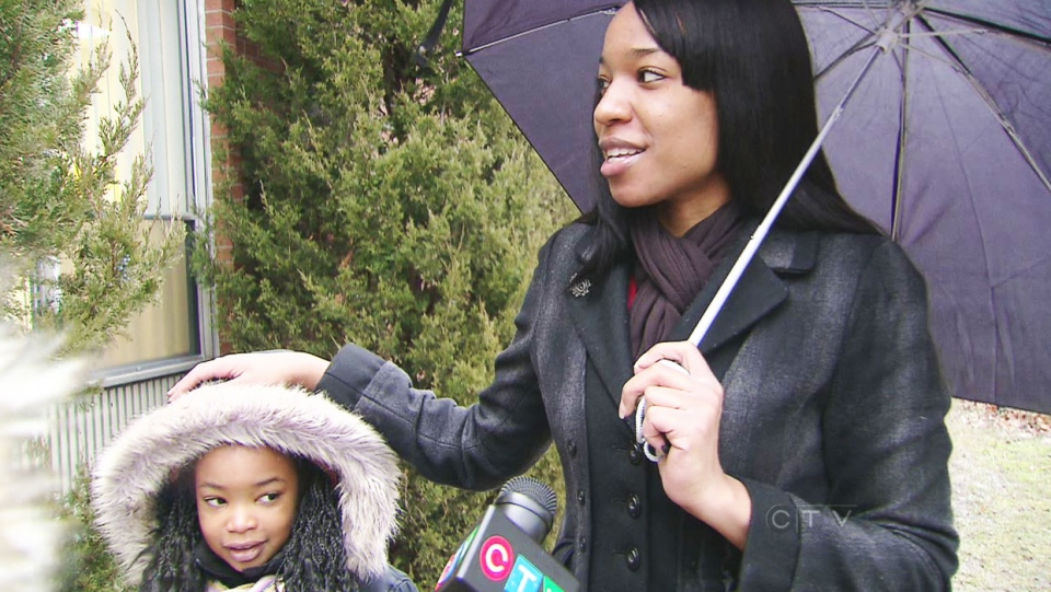 A parents shares her frustration over the decision to open elementary schools after an early-morning labour board ruling deemed a planned walkout by teachers to be illegal on Friday, Jan. 11, 2013.