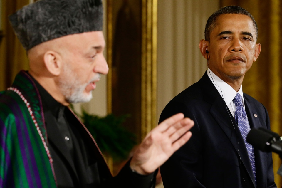 U.S. President Barack Obama listens as Afghan President Hamid Karzai speaks during their joint news conference in the East Room at the White House in Washington, Friday, Jan. 11, 2013. (AP / Charles Dharapak)