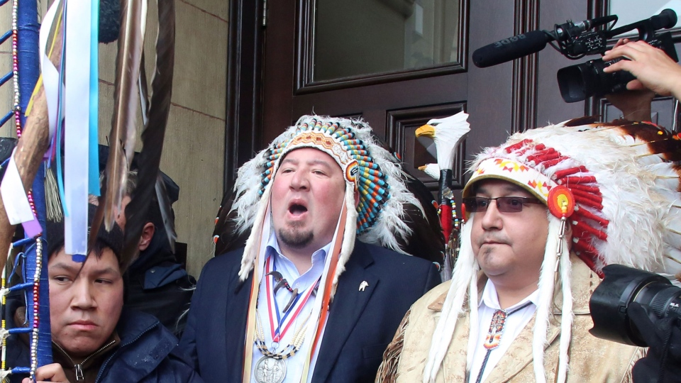 Grand Chief Derek Nepinak of the Assembly of Manitoba Chiefs addresses the crowd of First Nations protestors after he attempted to get into Langevin Block for the meeting between Prime Minister Stephen Harper and First Nations Chief Shawn Atleo and other First Nations Chiefs in Ottawa, Friday January 11, 2013. (Fred Chartrand / THE CANADIAN PRESS)