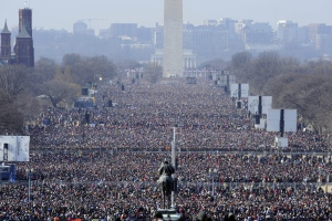 FILE - In 2009 a large crowd  gathered on the U.S. National Mall looking from the Capitol toward the Washington Monument and Lincoln Memorial listening to the inaugural address of U.S. President Barack Obama.