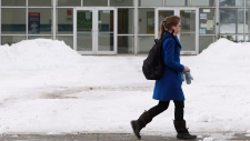 student walks by Hawthorne Public School