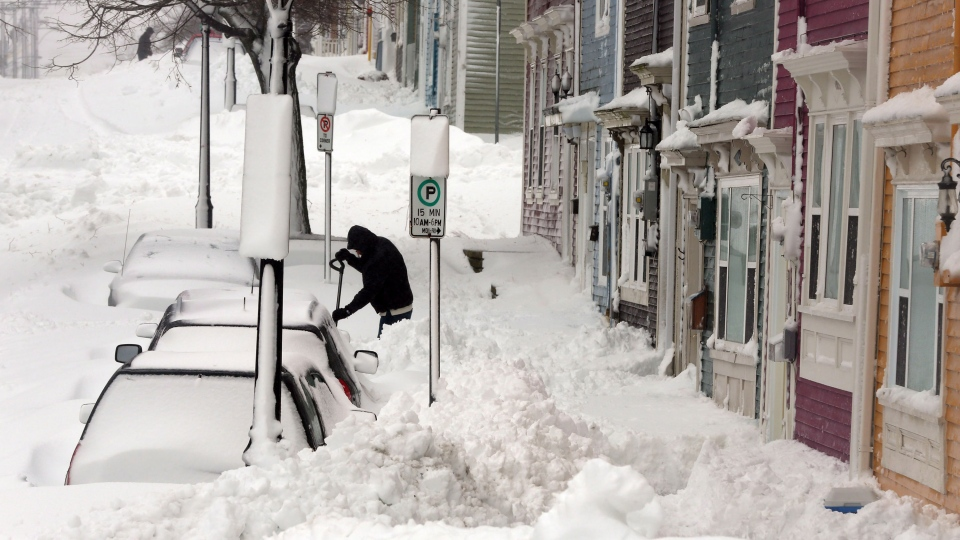 Residents along Gower Street in downtown St. John's try to dig out in the aftermath of a snowstorm that dropped over 40 centimetres of snow by Friday morning, Jan. 11, 2013. (Paul Daly / THE CANADIAN PRESS)