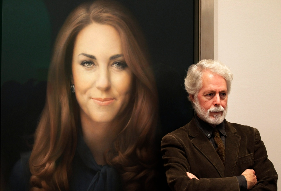 Artist Paul Emsley poses for photographers next to his newly-commissioned portrait of Kate, Duchess of Cambridge, on display at the National Portrait Gallery in London, Friday, Jan. 11, 2013. (AP Photo / Sang Tan)