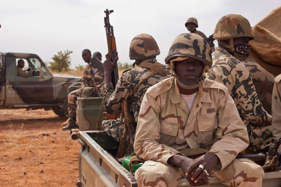Soldiers from a Malian army special unit sit atop pick-ups, following a training exercise in the Barbe military zone, in Mopti, Mali, Nov. 24, 2012. (AP / Francois Rihouay)